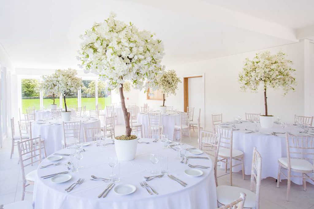 Arley white wedding dining with white flower tree decoration