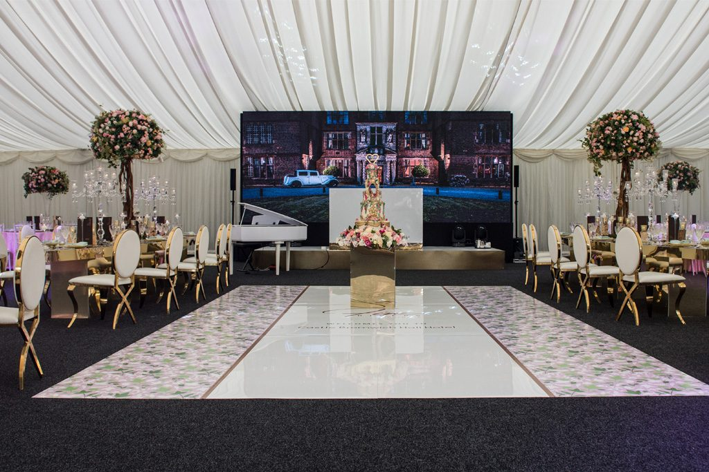 Wedding venue with stage and cake in the middle